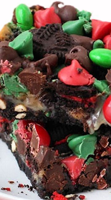 Magic Bars. Each bar is layered with Oreo Cookies, toffee bits, peanuts, pretzels, holiday chocolate chips and Christmas M&M's! Make the ultimate holiday desserts and give them as gifts to your friends and co workers!