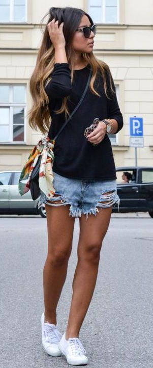 Cool summer outfit with denim shorts and a basic black top.