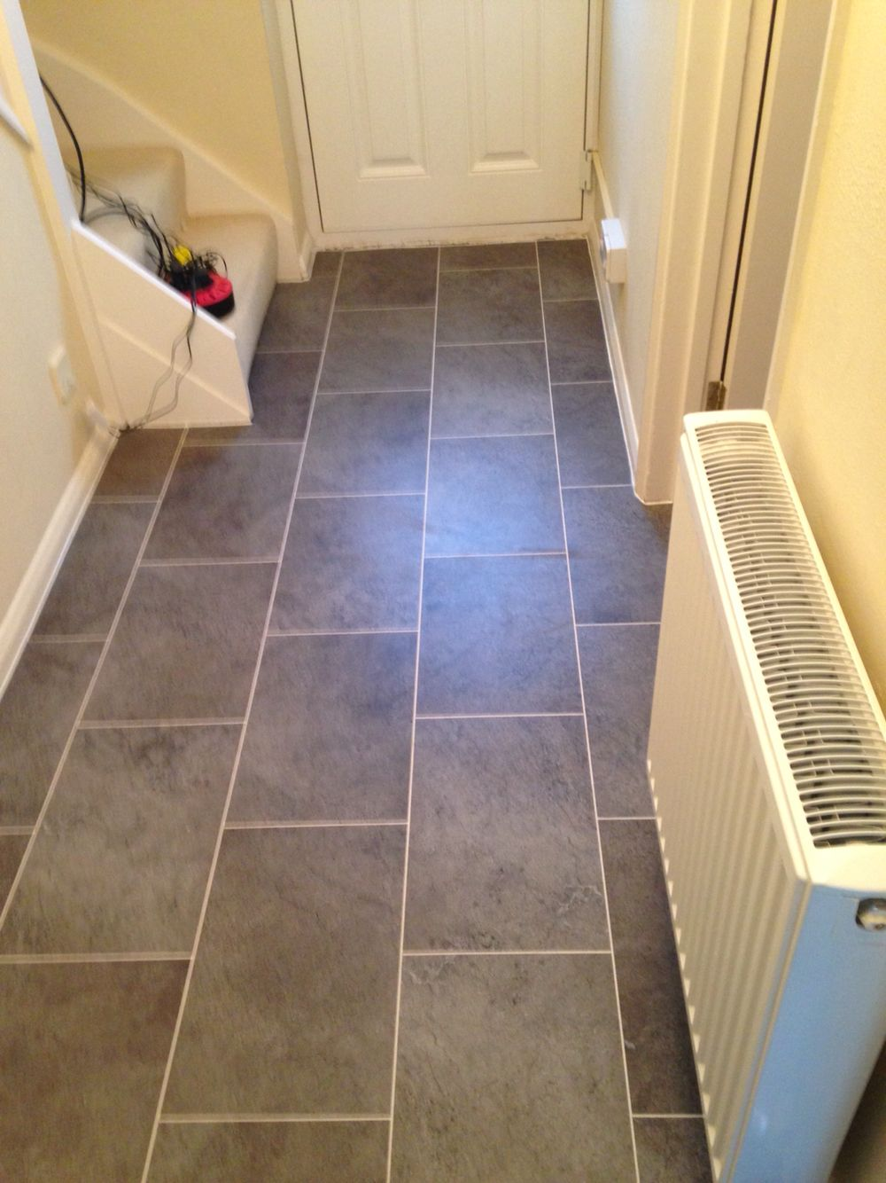 Karndean tiles fitted to a hallway & kitchen.