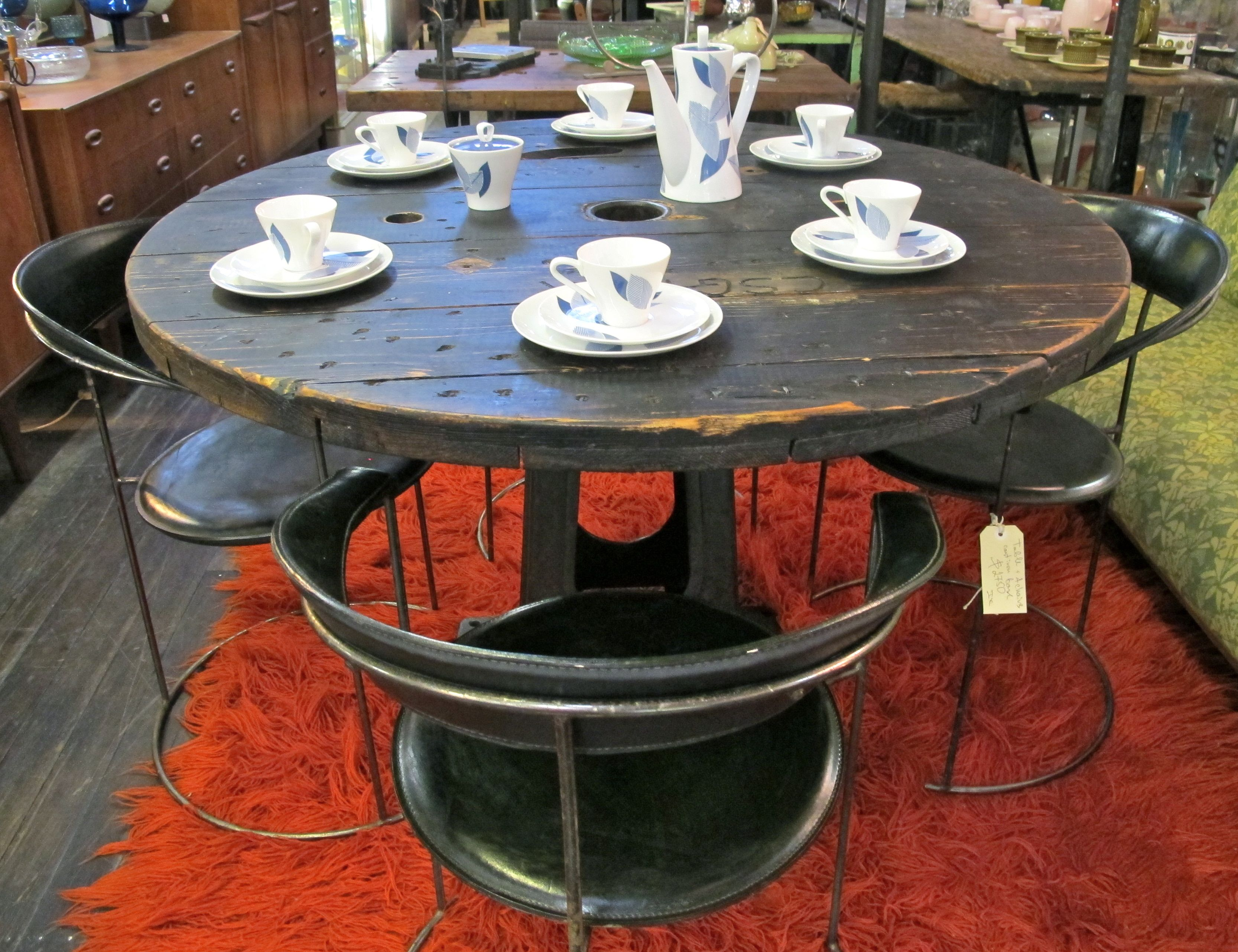 large cable reel top table on a heavy re-purposed cast metal base