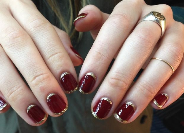 Beautiful nail design with metallic accents.