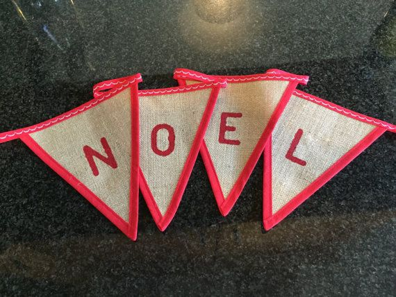 Hessian bunting with red Noel lettering, finished with a red rim. Total length approx 1m If you want it to say something else e.g. Peace, Joy, Merry Christmas, Christmas with the Jones please get in contact for a quote.
