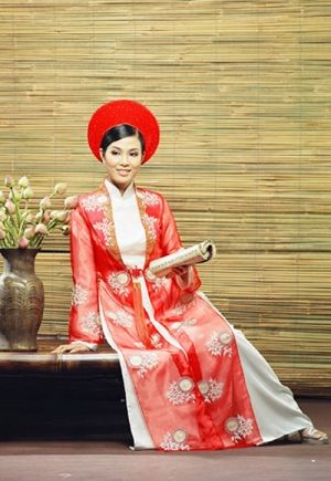 Ao dai with traditional coat. Mom wore a red ao dai with a lace coat