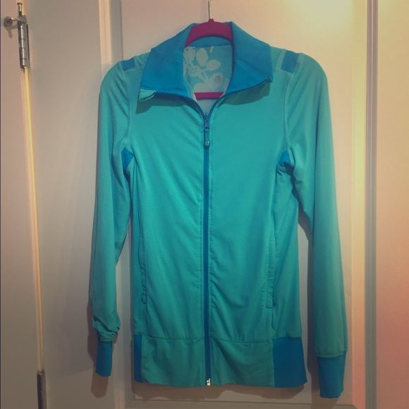 Lululemon reversible teal yoga running jacket 6 Purchased from another posher, in EUC (no pilling, stains or tears). Has drawstring back tie to adjust waist width. Super cute! lululemon athletica Jackets & Coats
