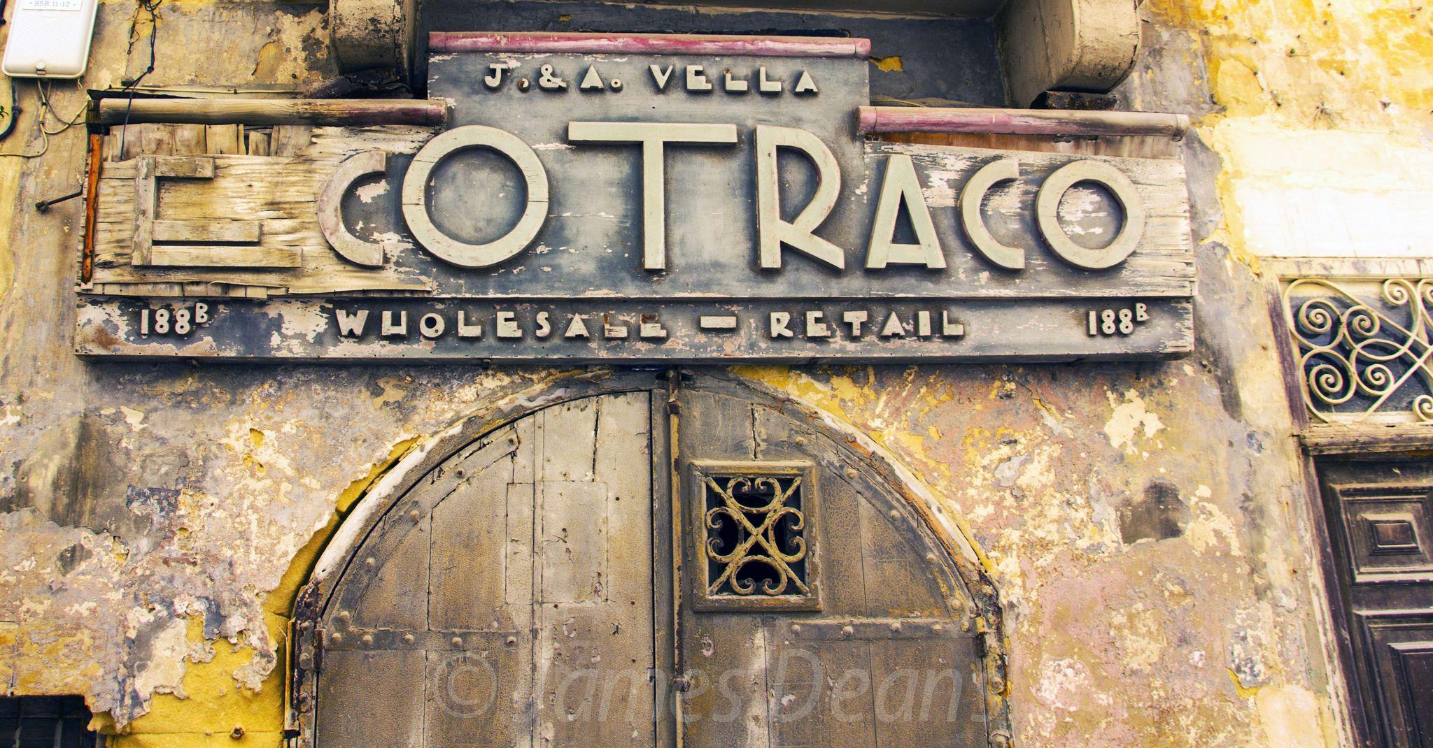 https://flic.kr/p/ooKvgr | Valletta 19 June 2014-0336.jpg | Old shop sign in Valletta. J & A Vella Ecotraco. 188B TRIQ SANTA LUCIJA - or in English 188B Saint Luke Street