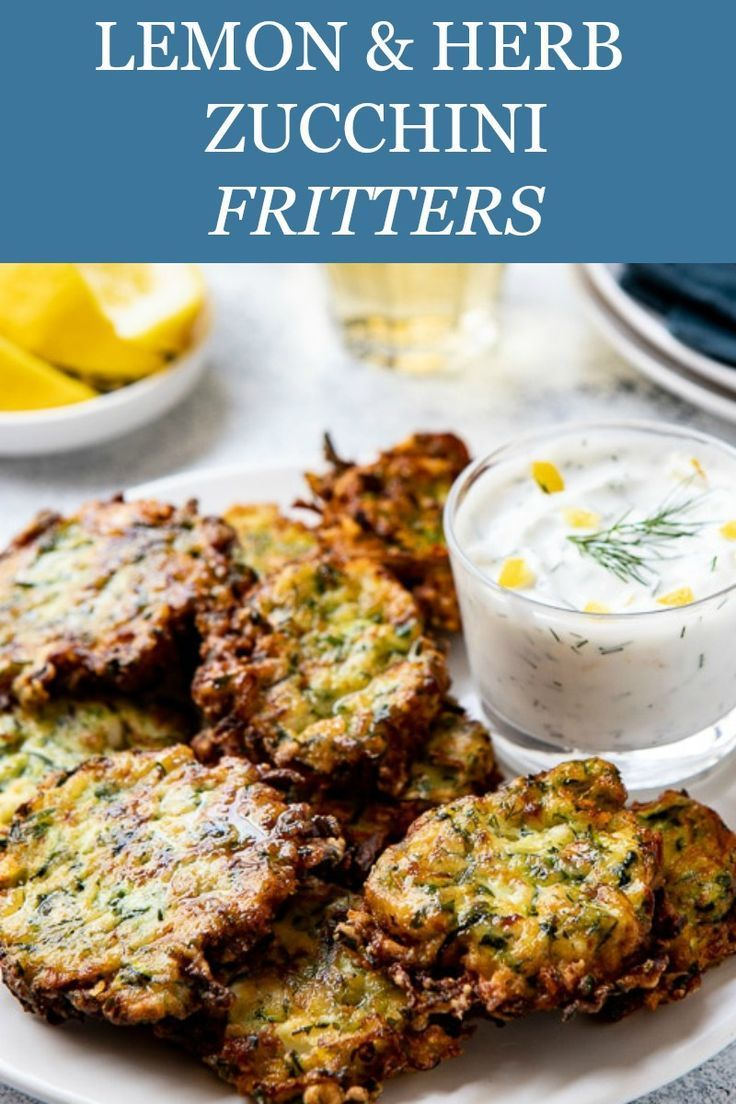 EASY & HEALTHY ZUCCHINI FRITTERS! Make ahead and freezable, these little zucchini cakes make a great appetizer, side or snack!