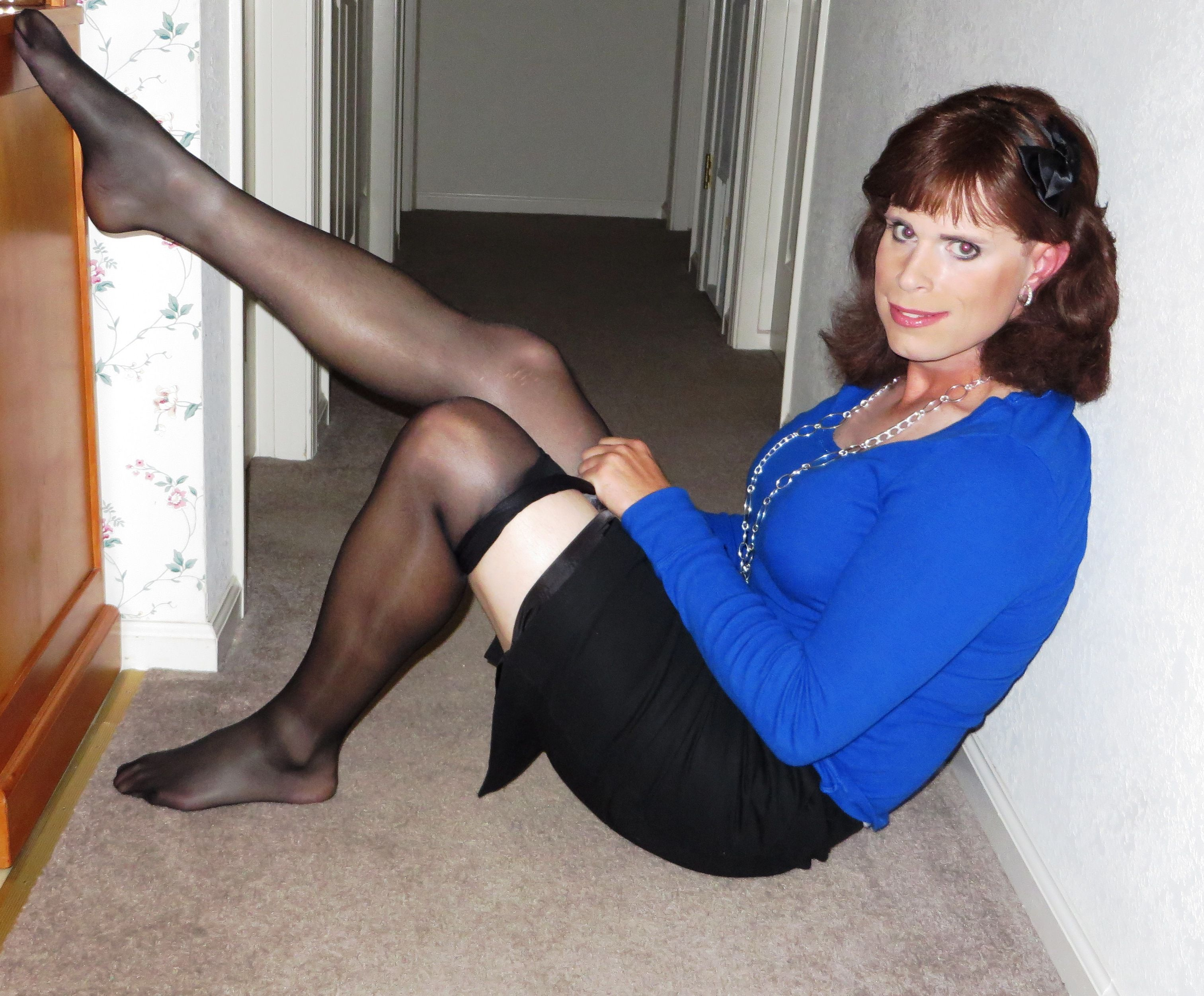 Shemale putting on pantyhose