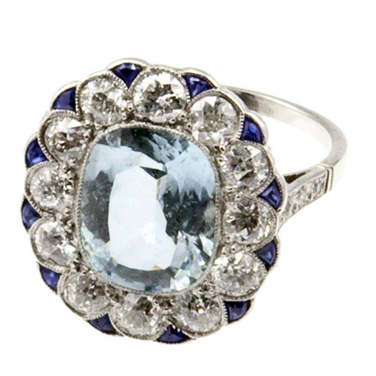 Belle Époque Aquamarine Target Ring with Diamonds and Sapphires. Circa 1910.
