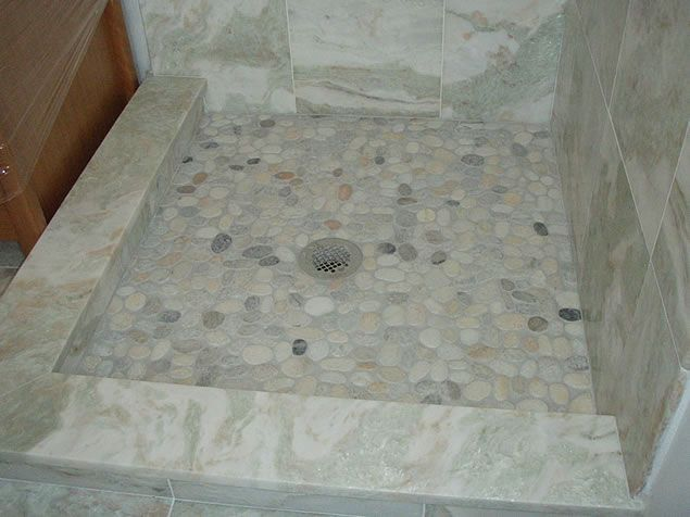 Low Marble Capped Shower Curb With Higher Tile That Slopes To The Drainu2026.The