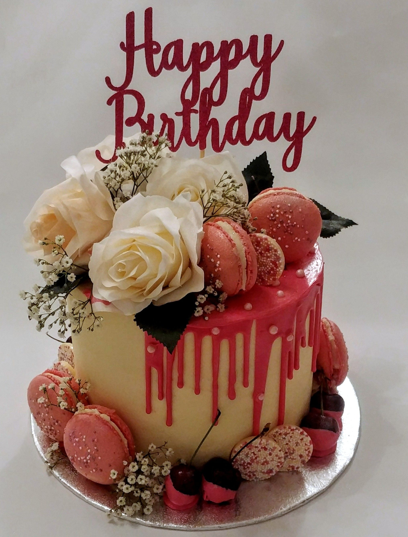 Bright pink drip cake happy birthday flower cake happy