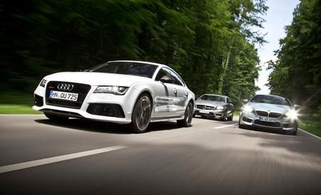 2014 Audi RS7 vs. 2014 BMW M6 Gran Coupe, 2014 Mercedes-Benz CLS63 AMG S-model  Civil War: Ballistic power and lavish trimmings combine to create a breed of four-seat supersedans.