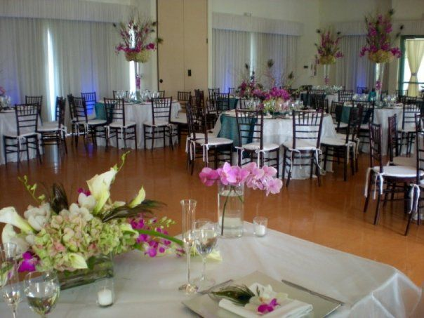 Ronald Shane Center Miami Beach Mahogany Chiavari Chairs Silver Square Charger Plates Teal Runner With Images Styling A Buffet Hydrangea Centerpiece Table Decorations