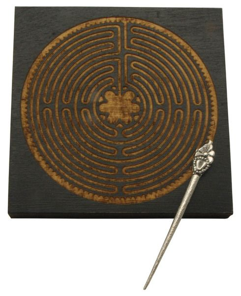 Based on a large-scale Cathedral labyrinth, this wooden labyrinth is ideal for a moment's mediation at your desk or counter. Dark color with light detail.