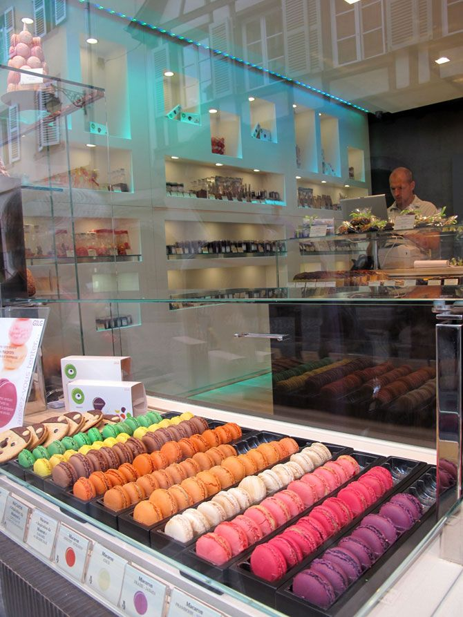 the rainbow of French macarons shine in this slick modern shop in Colmar, France. Who could ever deny a macaron when displayed in colour gradients like this? Good Lord help us all.