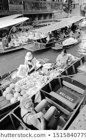 DAMNOEN SADUAK THAILAND  DECEMBER 24 2013 People visit Damnoen Saduak floating market It is the most popular floating market in Thailand and white white photo saduak