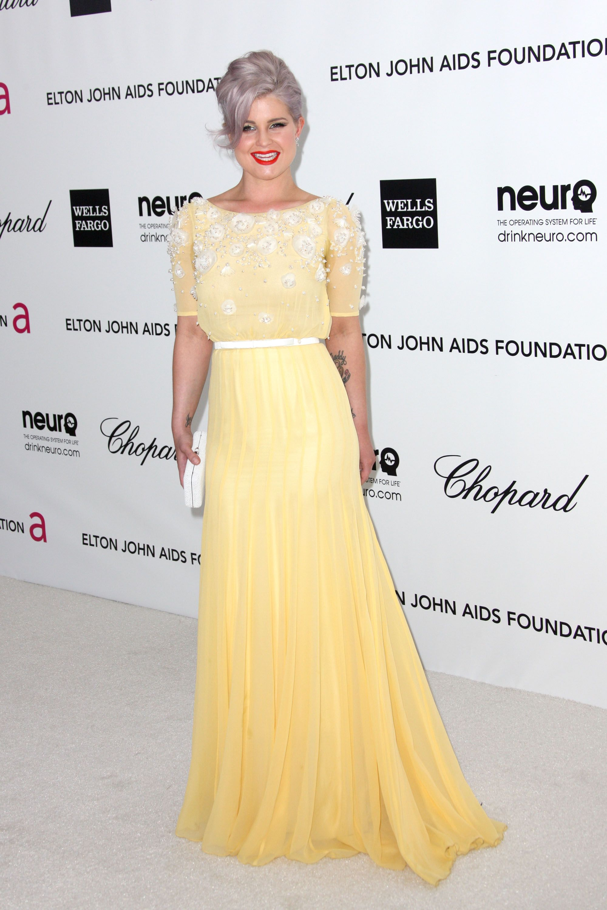 Kelly osbourne went for a sweet style in a daffodil yellow gown by
