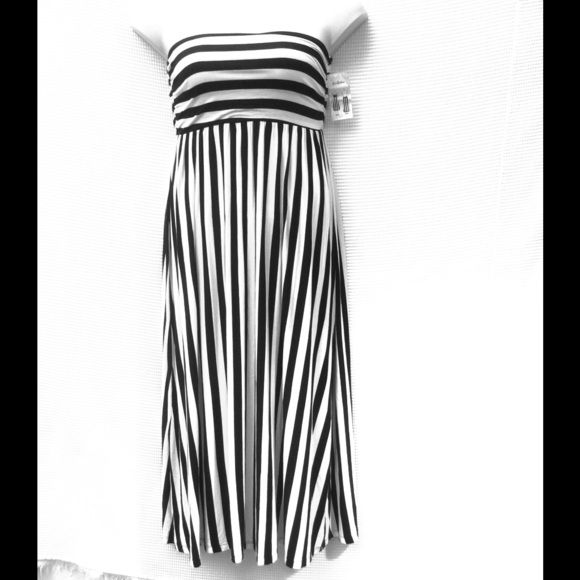 """New Bellatrix Black & White Dress OR Skirt M New black & white striped dress OR skirt. Bodice/waistband has touched elastic sides. Measured flat: top: 28-40"""", length: 42"""" rayon/spandex. Wash cold Bellatrix Skirts"""