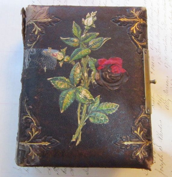empty antique tintype CDV album - leather cover with embossed ROSE motif - has damage, great for altered art, paper arts, heritage art. .