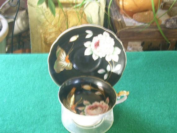 Hand Painted Tea Cup and Saucer by Rocky1975 on Etsy, $25.00