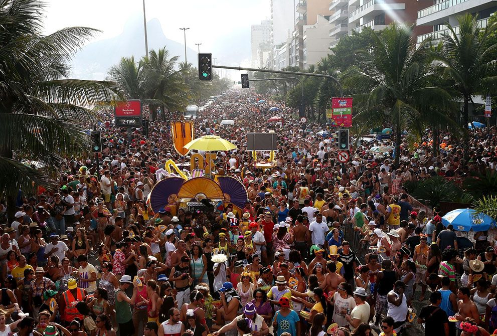 "Revelers parade during the ""Simpatia e Quase Amor"" street carnival bloco along Ipanema Beach in Rio de Janeiro, Brazil, on March 2, 2014. (Mario Tama/Getty Images)"