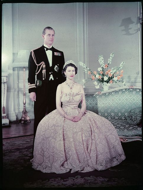 Queen Elizabeth the second seated in front of Prince Philip, Duke of Edinburgh / La reine Elizabeth II assise devant le prince Philip, duc d'Édimbourg   #QEII #UK #monarchy
