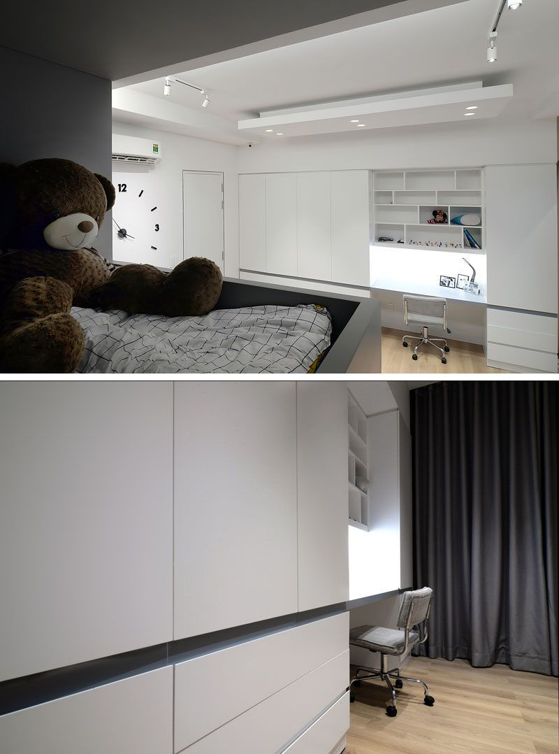This modern kids bedroom features a custom designed built-in bunk bed with stairs, and a wall full of closets with space for a study area. #KidsBedroom #BunkBeds #BuiltInBed #Closets