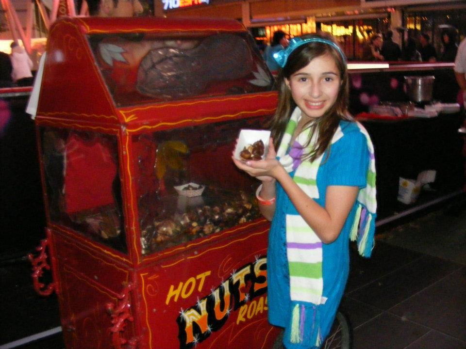 Actress Victoria Strauss enjoying Hot Roasted Chestnuts