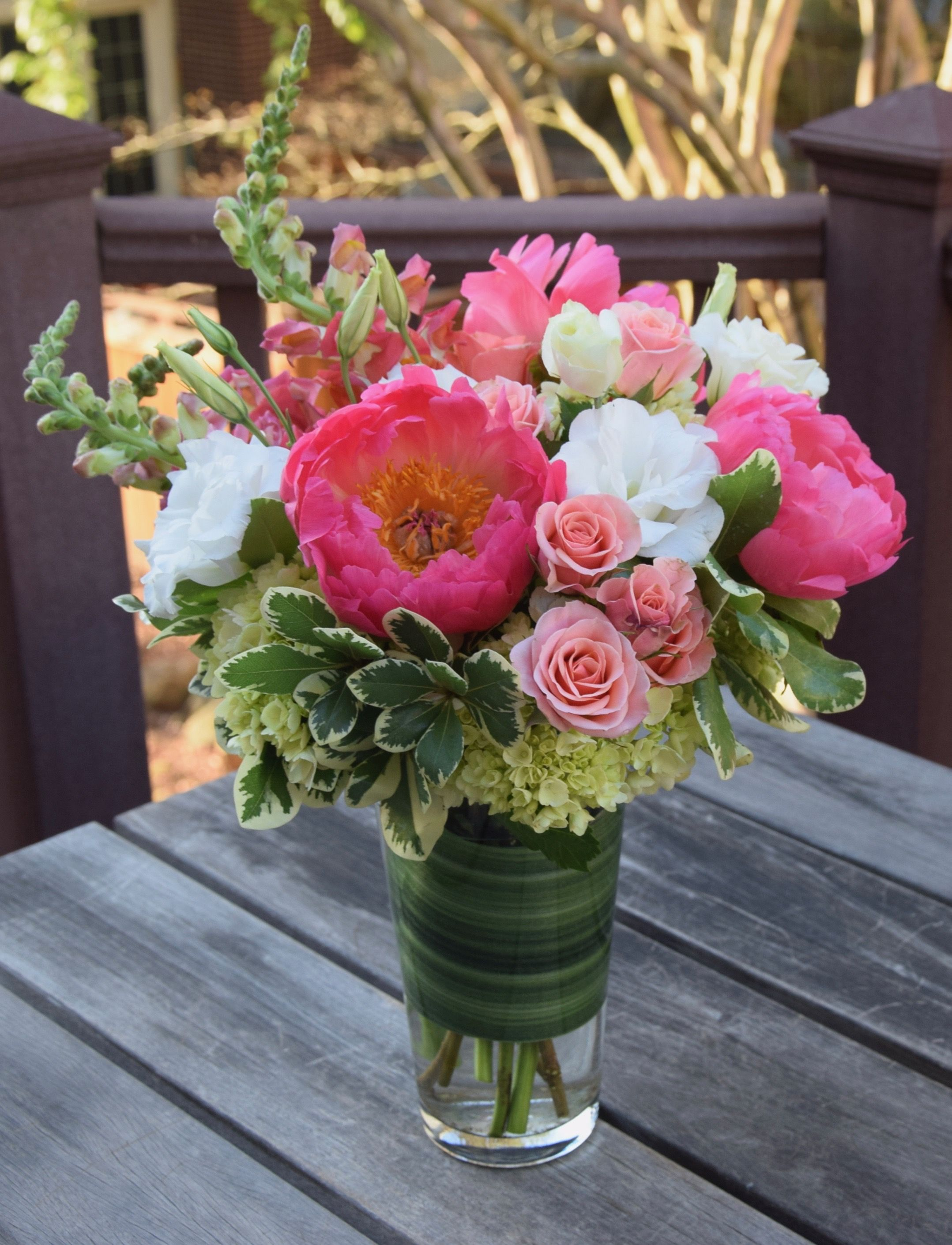 Flower arrangement with coral peonies lisianthus spray
