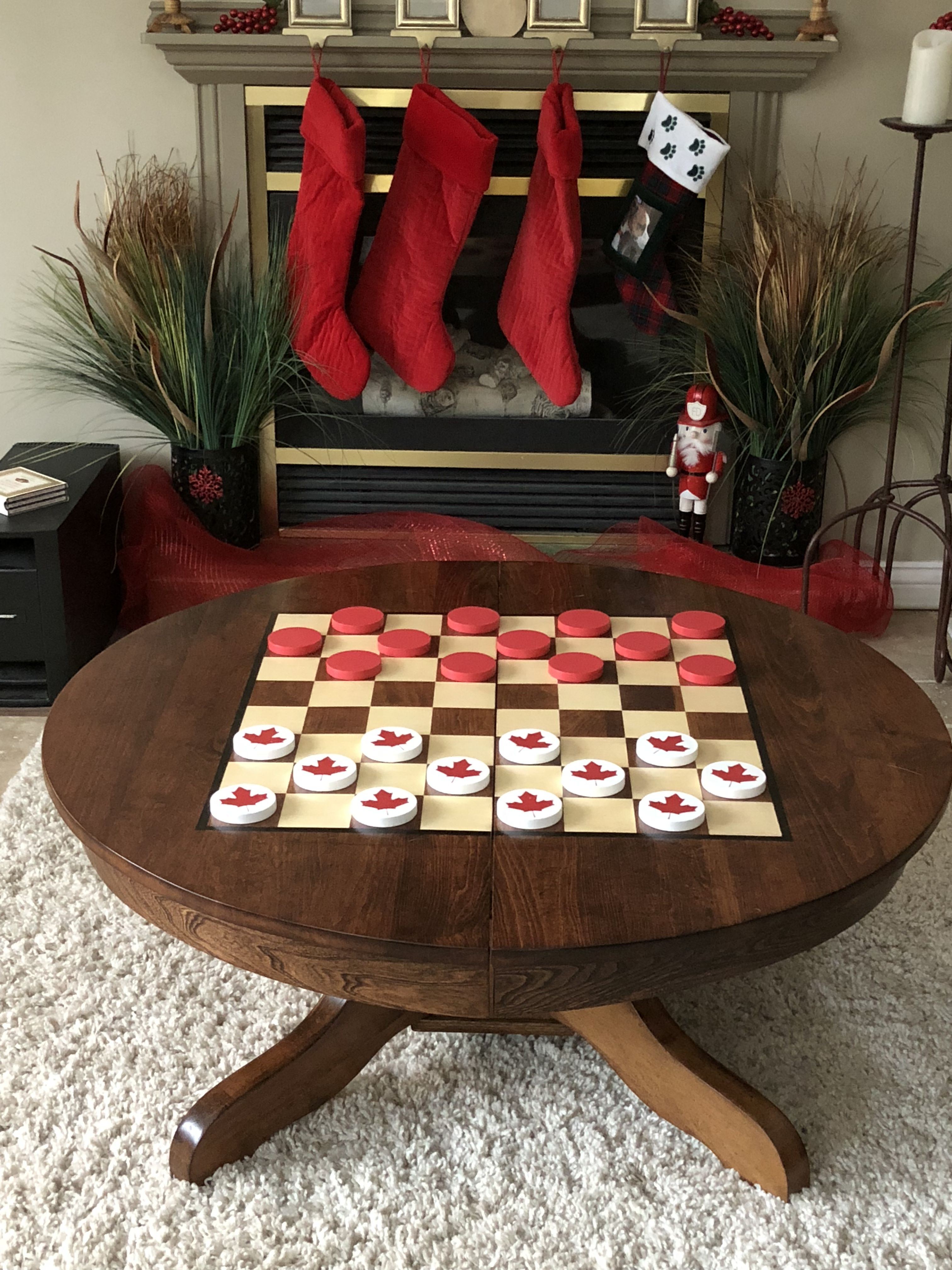 Our game table with the 150 year Canada checkers. Table