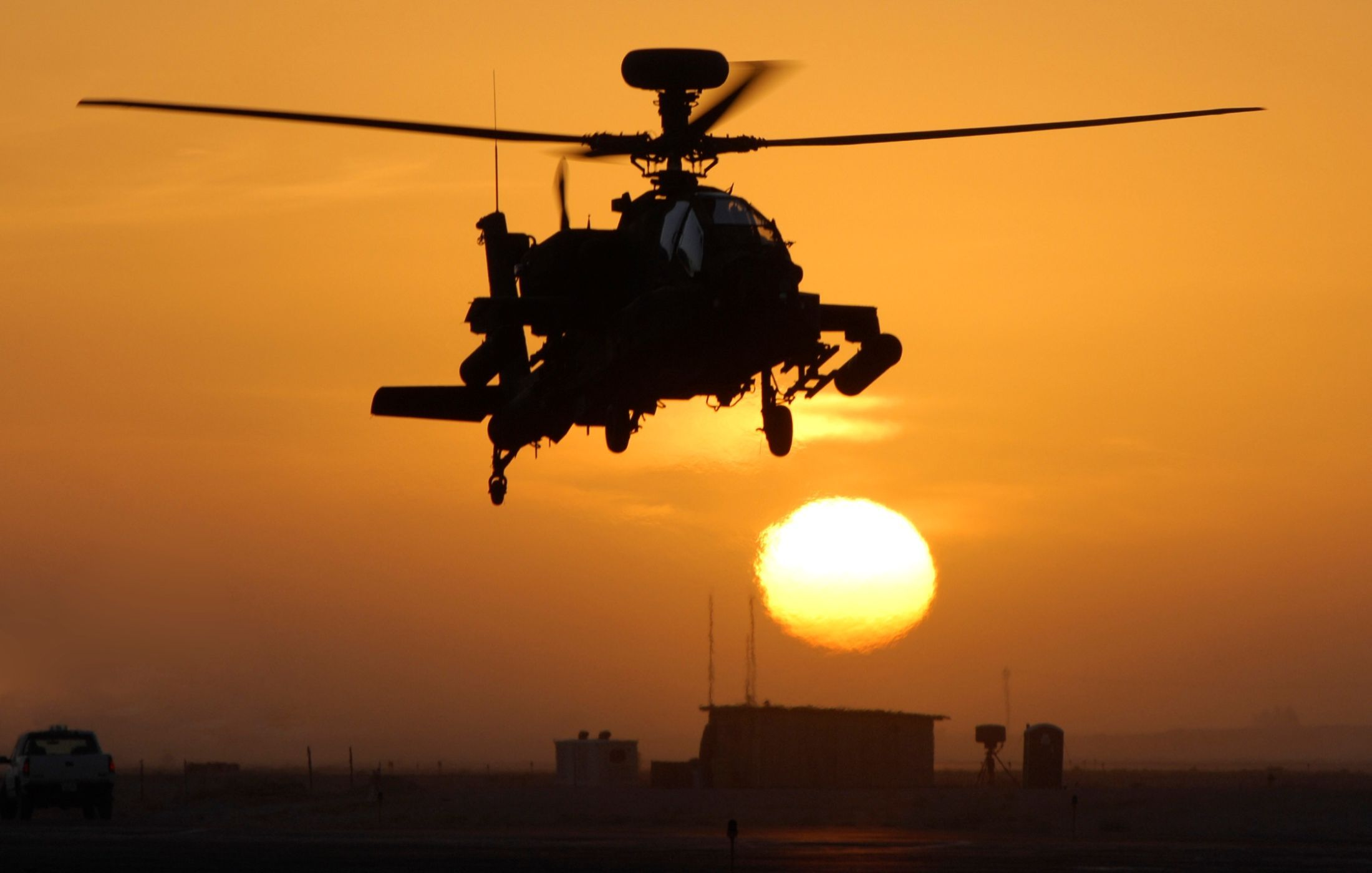 apache helicopter at sunsetunknown artist | helicopters