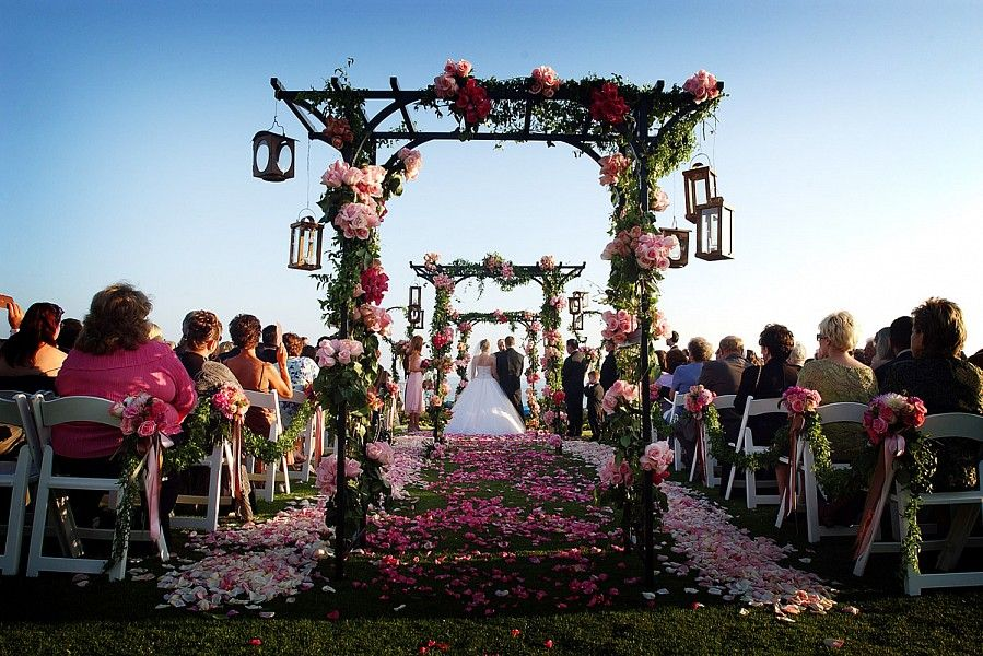 Outdoor Wedding Ceremony In Laguna Beach With Pink Flowers And Petals Decorating The Aisle Original
