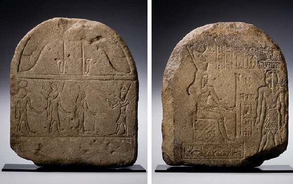 EGYPTIAN SANDSTONE DOUBLE-SIDED STELE WITH A PHARAOH ENTHRONED UPON A DAIS. Probably a representation of Nectanebo I, he wears the double crown, tripartite wig, and kilt, and holds the was-scepter. Approaching from the right is the figure of a prince; with extensive hieroglyphic text. Reverse: A pharaoh standing right greets Amun, Horus, and Isis. XXXth Dynasty, 380-343 BC.