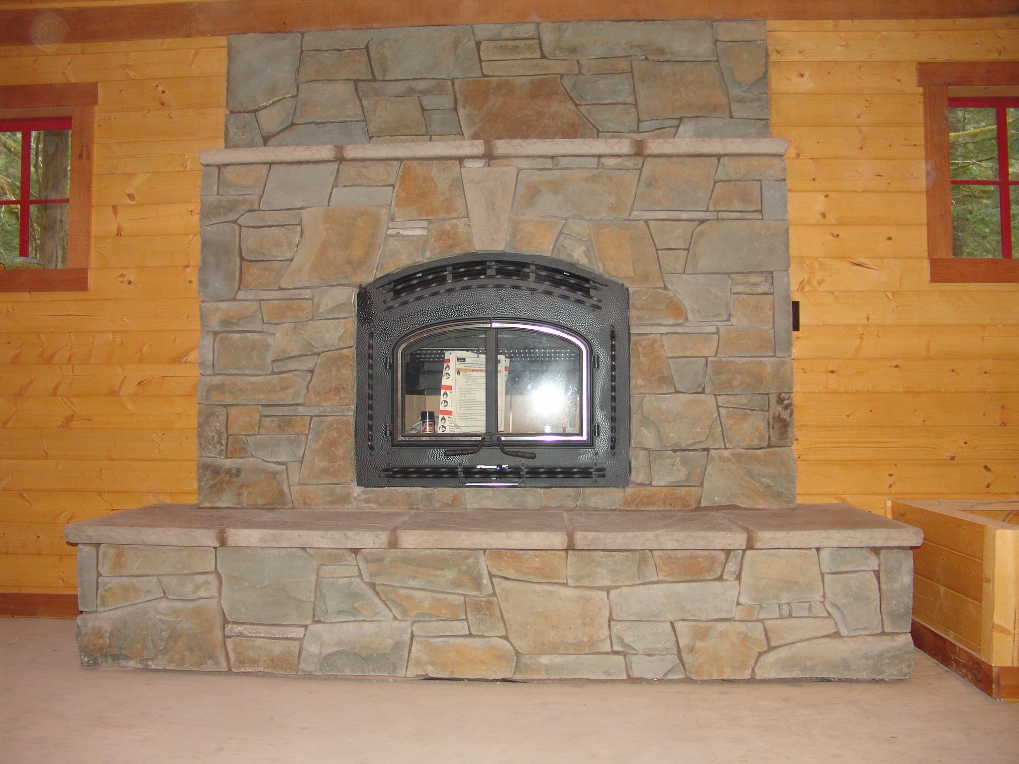 Natural Stone Cabin New Construction Wood Burning Raised Hearth Stone Slab Hearth Slab Rhododendron Indoor Fireplace Fireplace Traditional Living Room