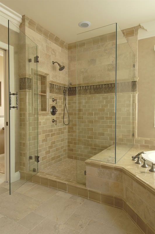 another example of shower bench joining tub surround. note the tile ...