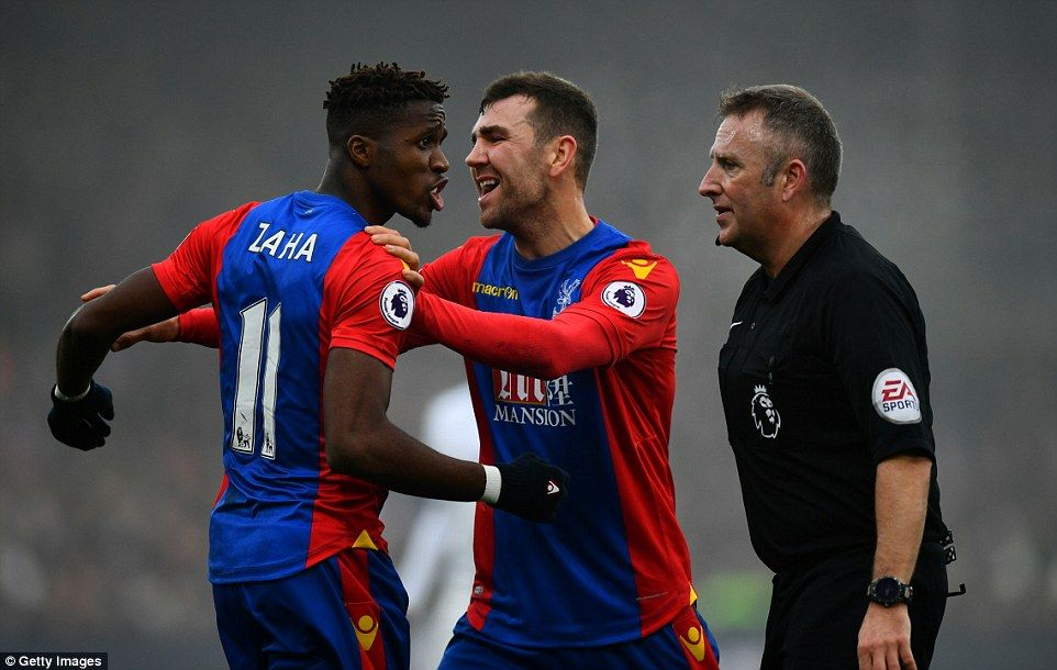 McArthur is forced to step in and calm Zaha down as the winger vents his fury at Moss following decision to award a free-kick