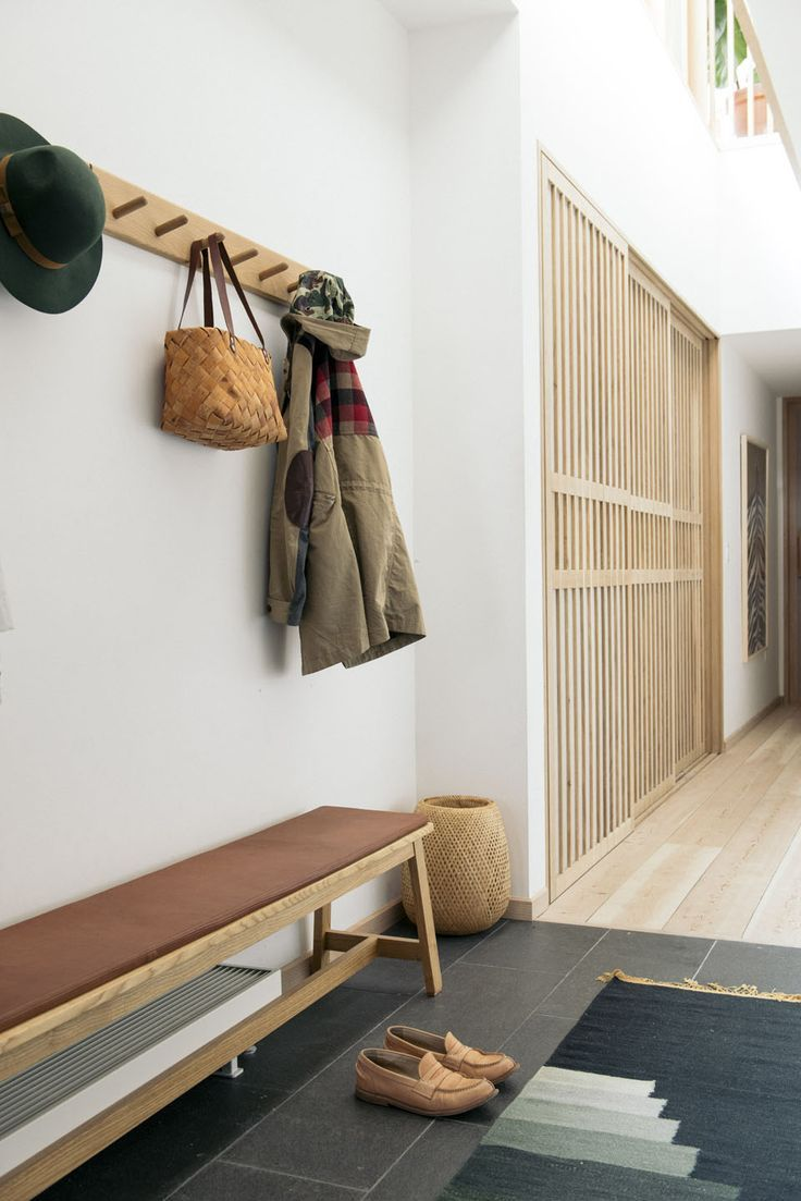 a cute bench and rug for the hallway