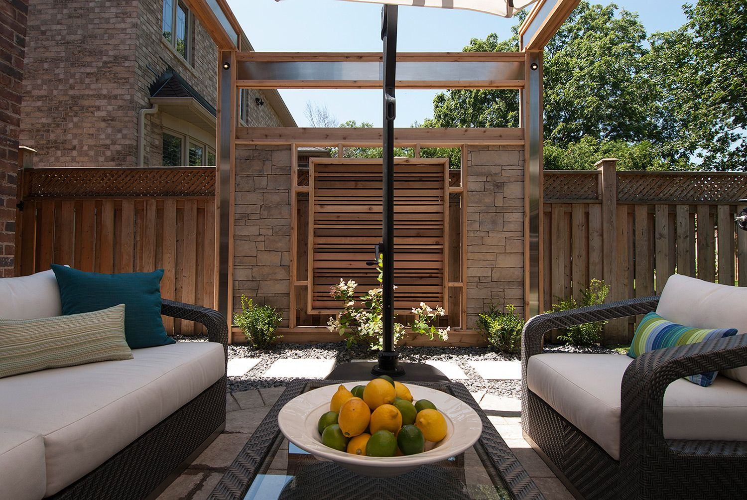 Stacked stone and cedar privacy screens lend a cozy and for Hanging privacy screens for decks
