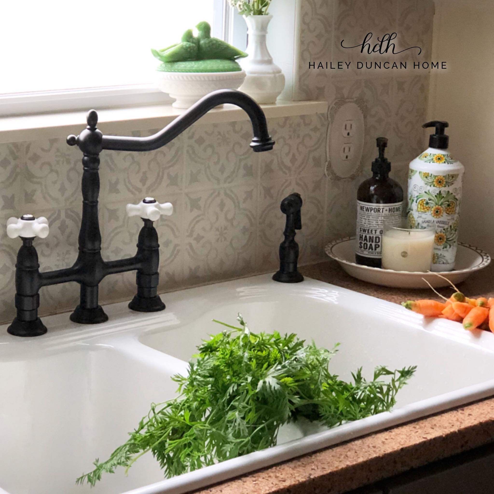 Farmhouse kitchen sink and matte black vintage faucet.
