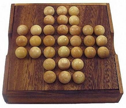Solitaire Marble - Wooden Brain Teaser Game. This is a version of Peg-Solitaire that I've played during occupational therapy. It's a fun thing if you like puzzles and it has many solutions!