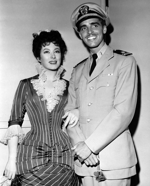 On leave from duty in the South Pacific, Lieutenant ... Greer Garson And Husband
