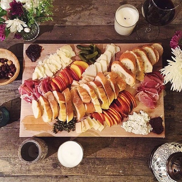 Rustic Back Yard Party / Make Your Own Sandwich Party: Served on a large wooden board; chutney/relish, cheeses, fresh peach slices, blueberry, cottage cheese, gherkins, ham, pastrami, parma ham, french bread slices, whatever you like...