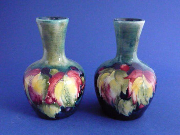 Pair of William Moorcroft 'Leaf and Berry' Miniature Vases c1928