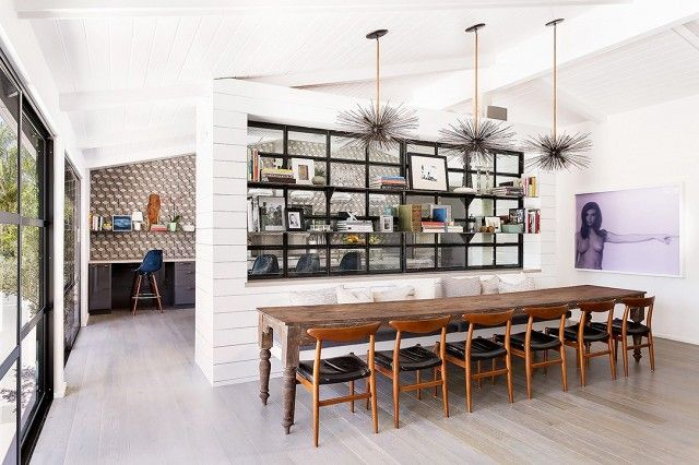 A rustic farm table pairs perfectly with statement chairs or bench seating, but we love getting creative by combining the two, as in this home by Brown Design Inc. The look is both clean and...