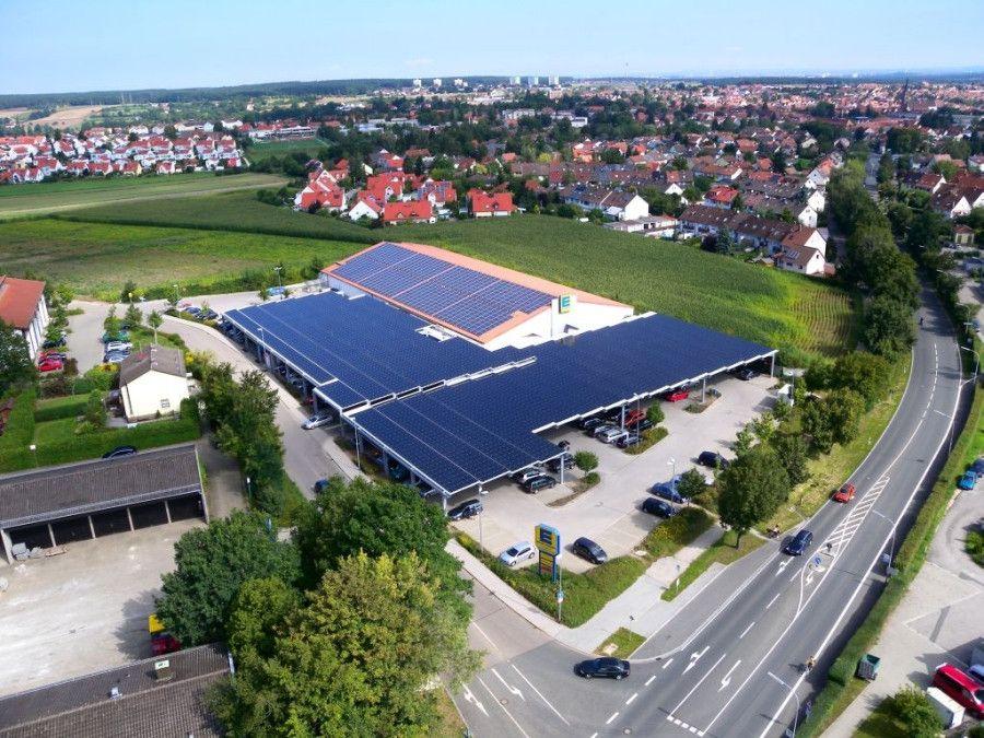 German Supermarket Car Park Covered In Solar Panels 900x675 Solar Solar Panels Solar Power Energy