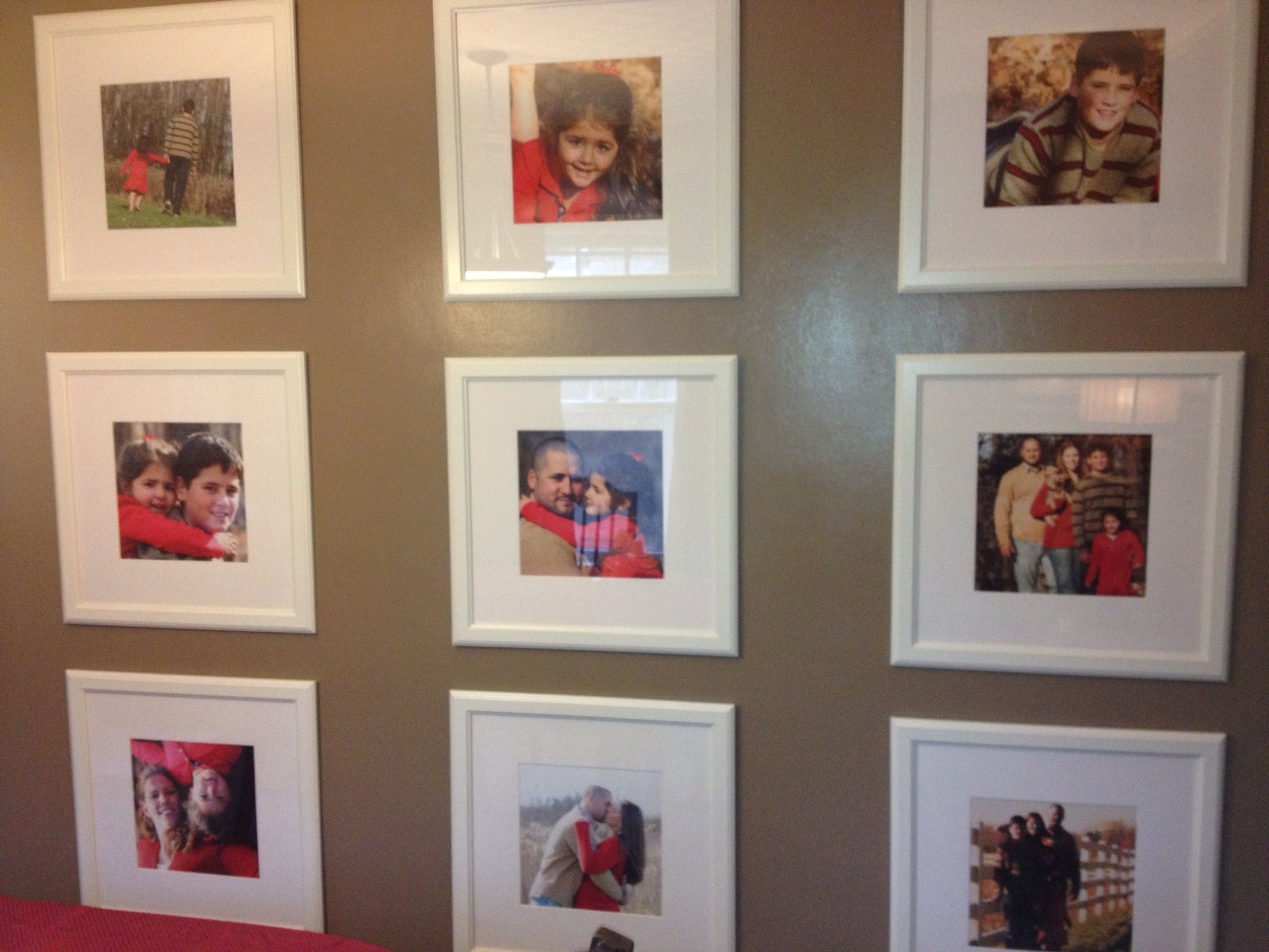 My photo wall in the dining room. 22x22 white frames from Ikea ...
