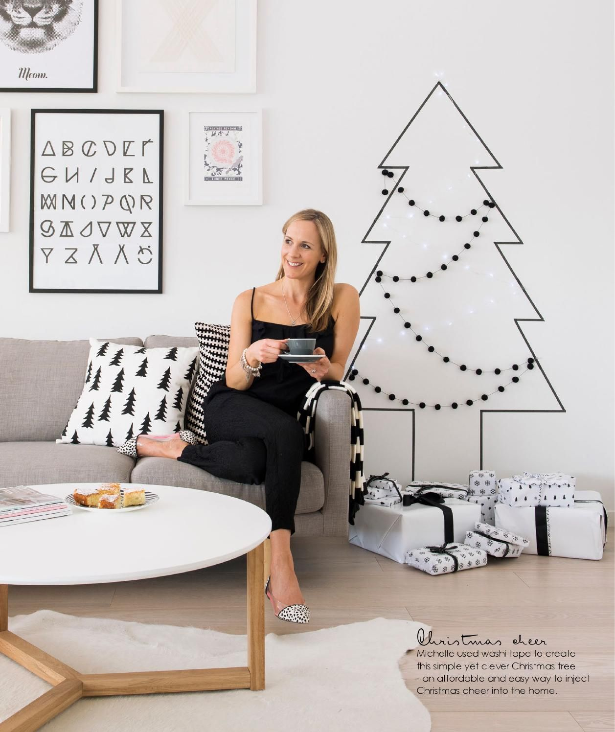 use washi tape and felt garland to make a Christmas tree on the wall ...