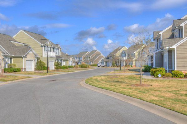 Community street view.  Heron Bay at Barefoot - Golf Condo Townhomes for Sale.  #heronbay  http://www.barefootrealty.com/heron-bay-townhomes/