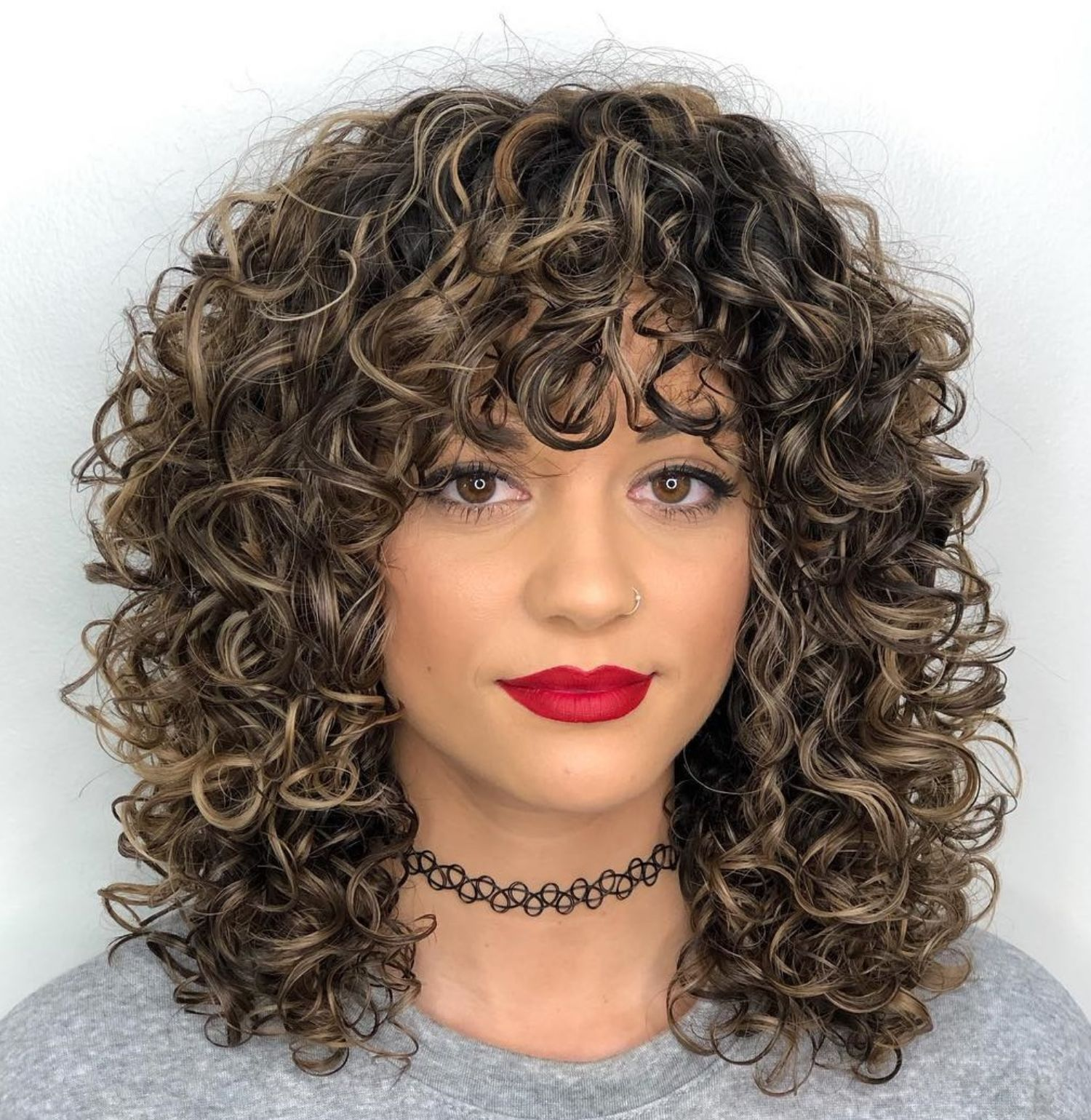 Mid Length Curly Hairstyle With Curly Bangs Mid Length Curly Hairstyles Curly Hair Styles Naturally Medium Curly Hair Styles