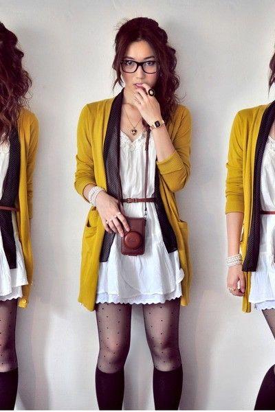 yellow cardigan, black knee-high socks, dotted black sheer tights, white dress, black frame hipster glasses, dark gray scarf