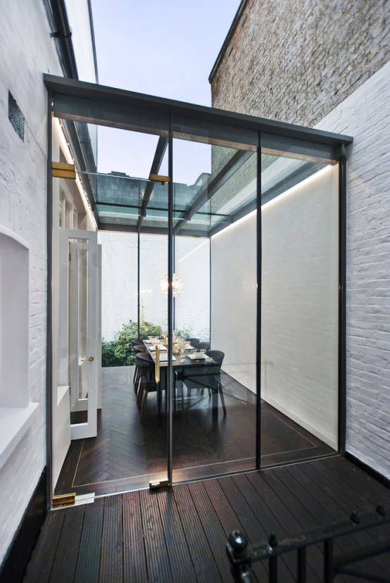 We D Love To Host Friends In This Lovely Glass Enclosed Dining Area Stylishentertaining With Images Modern Conservatory House House Design